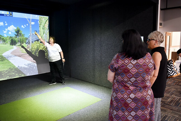 Performance Physical Therapy Co-Owner Angie Beaver shows a golf simulator at the new building in Daniels. (Chris Jackson/The Register-Herald)