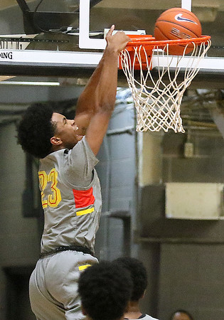 (Brad Davis/The Register-Herald) Oak Hill Academy's Darrick Jones Jr. goes up for a dunk against Crestwood Prep during Big Atlantic Classic action Wednesday night at the Beckley-Raleigh County Convention Center.