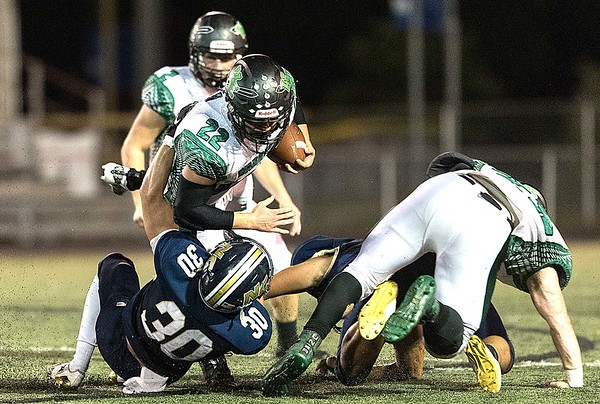 Wyoming East ball carrier, Caleb Bower, is tackled by Nicholas County's Tyler Sedlock. Chad Foreman for the Register-Herald.