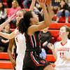 (Brad Davis/The Register-Herald) Oak Hill's Samiah Lynch drives to the basket as Greater Beckley Christian's Allie Smith defends Friday night in Prosperity.