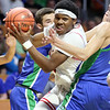 Oak Hill's Andrew Work (0) drives though the Robert C. Byrd defense during their West Virginia State Championship Class AA Quarter Finals in Charleston on Thursday. (Chris Jackson/The Register-Herald)
