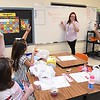 Crescent Elementary School first grade teacher Kayla Boyd , going over her morning work schedule with her class.<br /> (Rick Barbero/The Register-Herald)