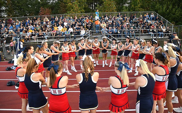Independence and Shady Spring cheerleaders join hand in prayer before game at Independence High School<br /> (Rick Barbero/The Register-Herald)