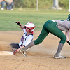 Independence's Nicole Kester (8) slides safely into second as Wyoming East's (15) hauls in the throw during their Class AA, Region 3, Section 1 softball game in Coal City on Tuesday.