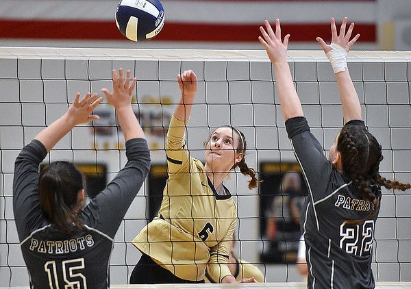 (Brad Davis/The Register-Herald) Shady Spring's Chloe Thompson spikes the ball between Independence defenders Harleigh Hall, left, and Jenna Harvey during the Class AA Region 3 championship tournament Saturday afternoon in Shady Spring.