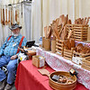(Brad Davis/The Register-Herald) Linville, Virginia-based woodcrafter George Lange mans his booth at the Appalachian Arts & Crafts Fair Saturday afternoon at the Beckley-Raleigh County Convention Center.