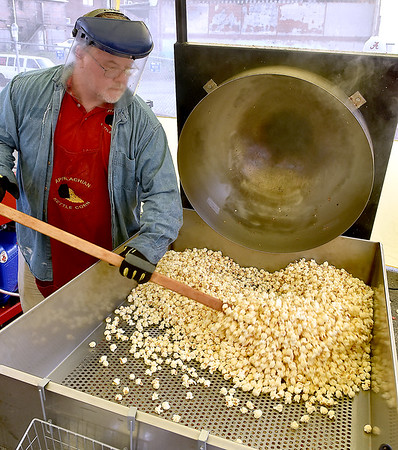 (Brad Davis/The Register-Herald) Appalachian Kettle Corn owner Doug Robinson pours a fresh batch during the Appalachian Festival Block Party August 24.