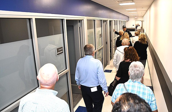 Cpt. Jake Corey leads a tour past the detectives offices of the new the Beckley Police Department on 501 Neville Street after the ribbon cutting dedication ceremony. <br /> (Rick Barbero/The Register-Herald)