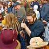 (Brad Davis/The Register-Herald) Band member Andrew Adkins, lower right, expertly picks his mandolin while weaving through a  grooving crowd as his band The Wild Rumpus entertains the masses during WV PubFest Saturday evening at Weathered Ground Brewery. The event is a massive, annual music festival-styled gathering put together by area musicians, artists and brewers to benefit West Virginia Public Broadcasting.
