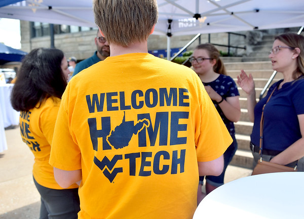 (Brad Davis/The Register-Herald) Staff and students mingle during the picnic portion of WVU Tech's official move-in day Sunday as the campus comes back to life for the start of the school year.