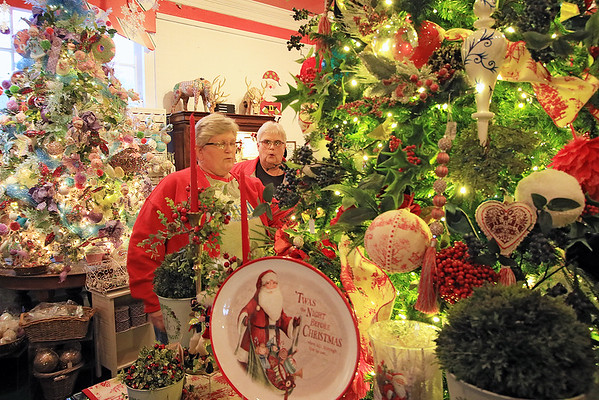 Jean Cheeseman, left, and Donna Saylor check out ornaments at Greenbrier Christmas Shop at the Depot in White Sulphur Springs Monday. (Jenny Harnish/The Register-Herald)