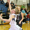 (Brad Davis/The Register-Herald) Shady Spring's #33 drives and scores as Riverview's Chloe Mitchem defends Friday night in Hinton.
