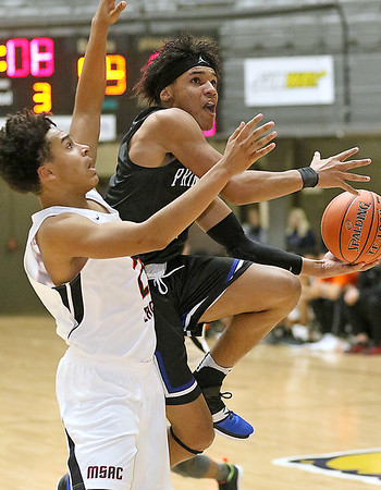 (Brad Davis/The Register-Herald) Princeton's Chiron Cannady drives and scores as South Charleston's Jayden Johnson defends during Big Atlantic Classic action Friday afternoon at the Beckley-Raleigh County Convention Center.