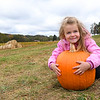 Jocelyn Martin, preschoolers at Crescent Elementary, hugs her pumpkin she picked out at the Okes Family Farm in Cool Ridge.<br /> (Rick Barbero/The Register-Herald)