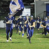 The Cavaliers charge the field ahead of Friday night's game against Midland Trail at Greenbrier West High School. (Jenny Harnish/The Register-Herald)