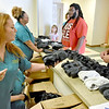(Brad Davis/The Register-Herald) Volunteer Katie Stover, left, helps distribute shoes during Valley College's Day of Caring Saturday afternoon.