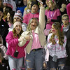 (Brad Davis/The Register-Herald) Liberty students react to events on the field as their Raider classmates take on Independence in The Battle of '76 Friday night in Glen Daniel.