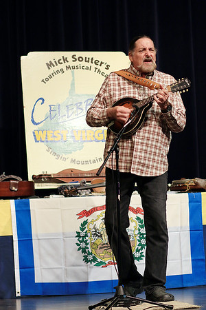 """Mike Souter performs his """"Celebrate West Virginia"""" one-man show for West Virginia Day at Tamarack Thursday. Souter is a multi-instrumentalist who accompanies himself with varies instruments and tells tales that celebrate the people, history and culture of West Virginia. (Jenny Harnish/The Register-Herald)"""