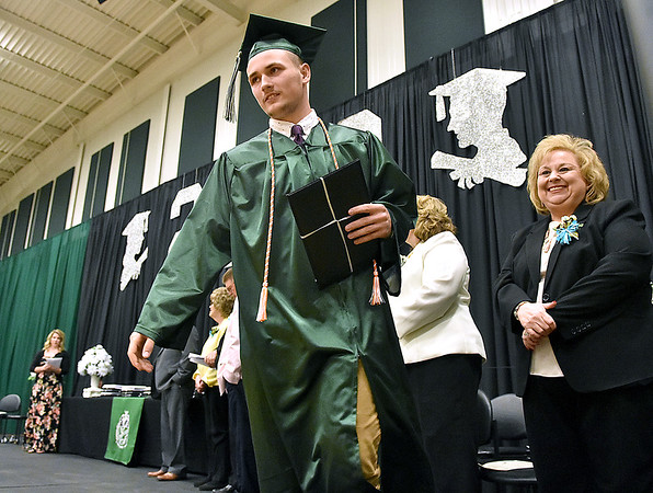 (Brad Davis/The Register-Herald) Scenes from Wyoming East's graduation Friday night in New Richmond.