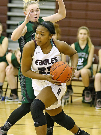 (Brad Davis/The Register-Herald) Woodrow Wilson's Victoria Staunton drives around Wyoming East's Jazz Blankenship Saturday night in Beckley.