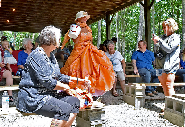 """(Brad Davis/The Register-Herald) Nolan Art, stage name """"Peachy,"""" seeks donations as he and other contestants battle, and glam, for who can collect the most money during the Miss Lilly Pageant fundraising contest at the Lilly Reunion Saturday."""
