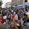 (Brad Davis/The Register-Herald) Main Street begins to pack with patrons Saturday night.