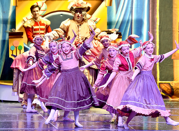 (Brad Davis/The Register-Herald) Mother Ginger watches from behind as her Ginger Snaps dance about during Beckley Dance Theatre and Beckley Performing Arts' presentation of The Nutcracker Sunday afternoon inside the Woodrow Wilson High School Auditorium.