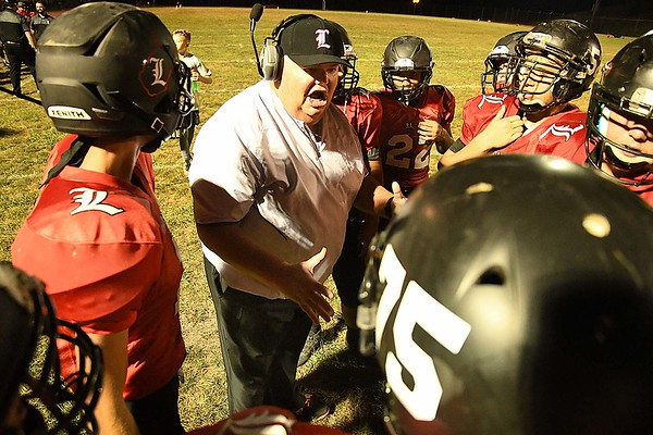 Liberty assistant coach Mark Montgomery, yells out instructions to his team during the first half against Pikeview at Liberty High School in Glen Daniels.<br /> (Rick Barbero/The Register-Herald)