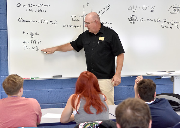 (Brad Davis/The Register-Herald) William Church, PhD and Mechanical Engineering Assistant Professor at WVU Tech, guides high school students through complex mathematical formulas during an engineering classroom session during the school's Camp STEM event Wednesday afternoon.