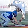 (Brad Davis/The Register-Herald) Terre Haute baserunner Mitchell Garrity's slide into 3rd flips over Miners 3rd baseman Brock Randels as he steals the bag Saturday evening at Linda K. Epling Stadium.
