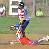 (Brad Davis/The Register-Herald) Herbert Hoover's Megan Seafler calls for time after making it into 2nd base with a double well before the ball got to Independence 2nd baseman Kaylen Parks Wednesday evening in Coal City.