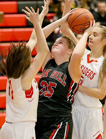 (Brad Davis/The Register-Herald) Oak Hill's Savannah Holbrook drives to the basket as Greater Beckley Christian's Allie Smith, right,  and Jess Arrington defend Friday night in Prosperity.