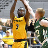 (Brad Davis/The Register-Herald) WVU Tech's Junior Arrey shoots from three-point range as Point Park's Mark Shehady defends Saturday afternoon at the Beckley-Raleigh County Convention Center.