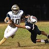 Drew Clark, of Shady Spring, breaks away from, Chance Spencer, of Independence during the first half at Independence High School<br /> (Rick Barbero/The Register-Herald)
