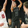 (Brad Davis/The Register-Herald) Wyoming East's Evan Preece shoots for three as Oak Hill's Khori bass defends during Big Atlantic Classic action Wednesday night at the Beckley-Raleigh County Convention Center.