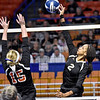(Brad Davis/The Register-Herald) Greater Beckley Christian's Zaniya Colin spikes the ball as Wirt County's Madison Richards defends during State Volleyball Tournament action Friday morning at the Charleston Civic Center