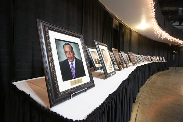 Photos of past recipients during the 32nd Annual Spirit of Beckley Awards Presentation at the Beckley-Raleigh County Convention Center in Beckley on Monday. (Chris Jackson/The Register-Herald)