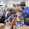 (Brad Davis/The Register-Herald) Festive volunteer Matt Huggins, right, helps shoppers find the right gifts during the Wyoming County Toy Fund event Sunday morning at Wyoming East High School.