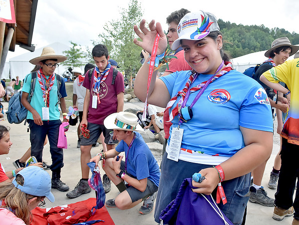 (Brad Davis/The Register-Herald) Mexican scout Sophia Martinez shows off a British bracelet after adding it to her collection in a trading area during the last day of World Scout Jamboree activities Thursday afternoon at the Summit Bechtel Reserve. Pop-up trading was a more frequent sight around the Jamboree as the days wound down, with scouts all trading items such as neckers, patches, bracelets, flags and anything else unique to their specific countries.