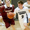 (Brad Davis/The Register-Herald) Shady Spring's Luke LeRose hustles up the court as George Washington's Evan Hughes (#42) defends during Friday action at the Little General Battle for the Armory.