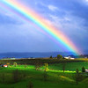 A rainbow appears before heavy rains and wind Sunday night in Sinks Grove in Monroe County. (Jenny Harnish/The Register-Herald)