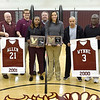 (Brad Davis/The Register-Herald) Woodrow Wilson girls basketball Hall of Fame inductees Karmella Wynne, middle right, and Angel Allen pose for a quick photo holding their new hardware and flanked by Beckley basketball coaches past and present among others during a ceremony at halftime of the Flying Eagles' game against Cabell Midland Friday night.