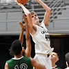 Greenbrier West's Collin O'Dell (44) puts a shot up over Fayetteville's Gabe Mack (13) during the third quarter of their Big Atlantic Classic basketball game in Beckley on Monday. (Chris Jackson/The Register-Herald)