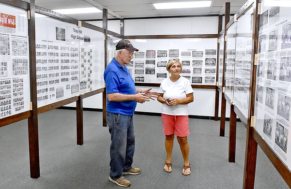 (Brad Davis/The Register-Herald) Lester natives Bill McMillion and Betty Goodwin marvel at the displays packed with photos and history of the once booming region inside the newly opened Trap Hill History Museum Friday afternoon inside the former Lester Elementary School, now Lester's City Hall.