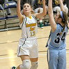 (Brad Davis/The Register-Herald) Greenbrier East's Autumn Hill drives and scores as Spring Valley's Caroline Asbury defends during Big Atlantic Classic action Wednesday night at the Beckley-Raleigh County Convention Center.