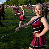 (Brad Davis/The Register-Herald) A Woodrow majorette notices the camera as the band takes the field for pregame Friday night in Beckley.