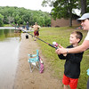 "Lisa Webb, of Beckley, helps her 5 year old son Owen Webb cast out his line during the Kids Fishing Derby held at Little Beaver State Park Saturday morning. West Virginia celebrates National Fishing and Boating Week with Free Fishing Weekend June 8 and 9.""This is the perfect time to take your son, daughter or grandchild to your favorite fishing spot and get them hooked on fishing,"" said Mark Scott, assistant chief in charge of fisheries for the West Virginia Division of Natural Resources (DNR). ""Free fishing weekends and our fishing derbies are a great way to enjoy the outdoors with family and friends.""<br /> (Rick Barbero/The Register-Herald)"