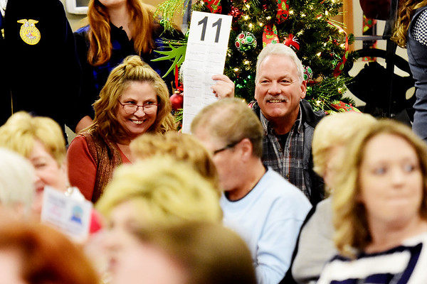 """Terri and Gary Stover, from Daniels, bid on the """"Thrasher Christmas Tree"""" during the 11th annual United Way of Southern West Virginia's Wonderland of Trees Auction at the J.W. And Hazel Ruby West Virginia Welcome Center in Mt. Hope on Friday. (Chris Jackson/The Register-Herald)"""