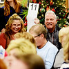 "Terri and Gary Stover, from Daniels, bid on the ""Thrasher Christmas Tree"" during the 11th annual United Way of Southern West Virginia's Wonderland of Trees Auction at the J.W. And Hazel Ruby West Virginia Welcome Center in Mt. Hope on Friday. (Chris Jackson/The Register-Herald)"