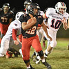(Brad Davis/The Register-Herald) Liberty's Ryan Simms carries the ball on a kick return against Independence Friday night in Glen Daniel.